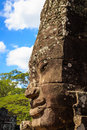 Single gigantic smiling faces in bayon side view of temple Royalty Free Stock Photos