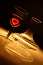 Single glass of red wine with glass decanter Royalty Free Stock Photo