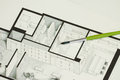 Single green brush set on real estate floor plan architectural isometric sketch sending a message for cold but elegant simplicity