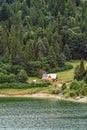 Single house on a lake Royalty Free Stock Photo