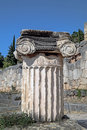 Single ionic order capital at delphi in gree archaeological site greece Royalty Free Stock Photos