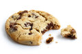 Single light chocolate chip cookie, bite missing with crumbs, is Royalty Free Stock Photo