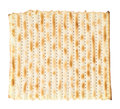 Single machine made matza flatbread piece isolated over the white background top view above Royalty Free Stock Photos