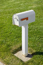Single mailbox and grass next to a sidewalk Stock Photography