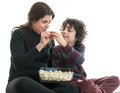 Single mom and son eating popcorn hispanic mother sharing with her eight years old latin family enjoying the simplicity of life Royalty Free Stock Image