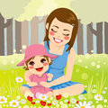 Single mother family beautiful enjoying nature with her adorable little daughter on the park Stock Image