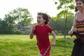 Single mother having fun with her child running and in a park Stock Photography