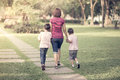 Single mother walking in the park with sons Royalty Free Stock Photo