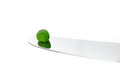 A Single Pea on a Knife Royalty Free Stock Images