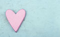 Single pink heart on light blue wooden background Royalty Free Stock Images