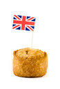 Single pork pie with union jack Royalty Free Stock Photos