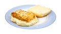 Single portion of haddock on an open bun a microwaved the bottom a white bread with the top to the side atop a blue striped plate Stock Photos