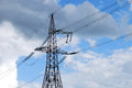 Single power line tower on the cloudy sky background Royalty Free Stock Photos