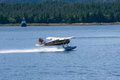 Single Prop Airplane Pontoon Plane flying in alaska mountains Royalty Free Stock Photo