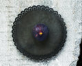 Single purple fig on rustic metal plate Royalty Free Stock Photo