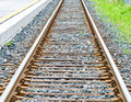 Single rail track railway with grass on the side Stock Photography