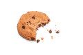 Single round chocolate chip biscuit with crumbs and bite missing, isolated on white from above. Royalty Free Stock Photo