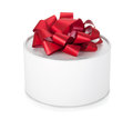 Single round gift box with red ribbon bow Royalty Free Stock Photos