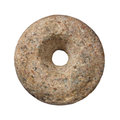 Single round rock with a central hole isolated. Royalty Free Stock Photo