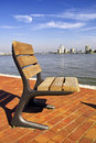 A single seat on the river bank in Rotterdam Royalty Free Stock Photos