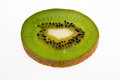 Single slice of fresh green fruit of kiwi isolated on white background Royalty Free Stock Photo