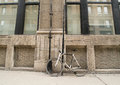 Single speed fixie bicycle parked against building wall downtown urban area Stock Photo