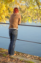Single standing woman watching tranquil autumn scenery Royalty Free Stock Photos