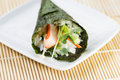 Single Sushi Cone on White Plate Royalty Free Stock Photo