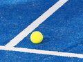 Single Tennis ball on a blue artificial grass court Royalty Free Stock Photo