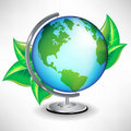 Single terrestrial school globe with leaves Royalty Free Stock Photography