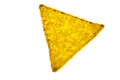 Single tortilla chip on light background Royalty Free Stock Photo