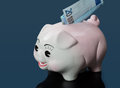 Single twenty euro bill inserted slot piggy bank blue reflection Stock Image