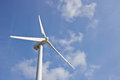 Single windmill for renewable electric energy production on blue sky Stock Image