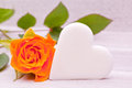 Single yellow rose with white sugar heart decoration Royalty Free Stock Photos