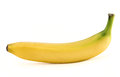 Single yellow spotless banana over white with an accurate stem isolated background Royalty Free Stock Photos