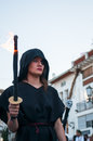 Sinister woman carrying a torch from performance in the roman party at forcall spain Stock Images