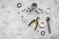 Sink drain parts and plumbing tools on grey stone background top view copyspace