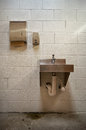 Sink public restroom with soap dispenser and paper towel holder Royalty Free Stock Photo