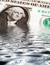 Sinking Dollar Stock Photography