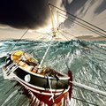 Sinking pirate brigantine on stormy seas Royalty Free Stock Photography
