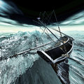 Sinking pirate brigantine on stormy seas Royalty Free Stock Photo