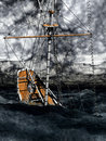 Sinking pirate brigantine on stormy seas Stock Image