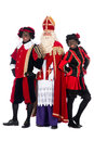Sinterklaas and a couple of his helpers zwarte piet black pete is character part dutch tradition called which is celebrated at Royalty Free Stock Photography