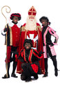 Sinterklaas and a couple of his helpers zwarte piet black pete is character part dutch tradition called which is celebrated at Stock Photos