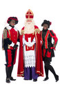 Sinterklaas and a couple of his helpers zwarte piet black pete is character part dutch tradition called which is celebrated at Stock Photo