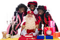 Sinterklaas and a couple of his helpers zwarte piet black pete is character part dutch tradition called which is celebrated at Royalty Free Stock Photo