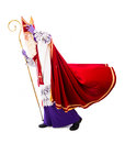 Sinterklaas walking in windy weather holding hat isolated on white background dutch character of santa claus Stock Photography