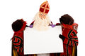 Sinterklaas and zwarte pieten with whiteboard Royalty Free Stock Photo