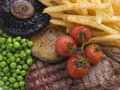 Sirloin Steak Chips and Grill Garnish Stock Images