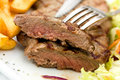 Sirloin steak with chips ,mushrooms,salad Royalty Free Stock Photo